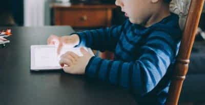 Kid playing with tablet